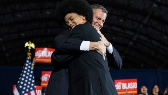 """De Blasio hugs Dante at his election night party. De Blasio's family appeared frequently in his campaign ads, Dante saying in one,<br />""""Bill de Blasio will be a mayor for every New Yorker, no matter where they live or what they look like. And I'd say that even if he weren't my dad."""""""