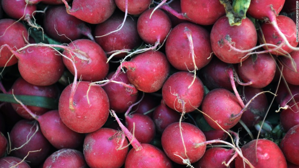 <strong>Radishes</strong><br />Water content: 95.3%<br /><br />These refreshing root vegetables should be a fixture in your spring and summer salads. They provide a burst of spicy-sweet flavor -- and color! -- in a small package, and more important, they're filled with antioxidants such as catechin (also found in green tea).<br /> <br />A crunchy texture also makes radishes a perfect addition to healthy summer coleslaw, with no mayo required. Slice them up with shredded cabbage and carrots, sliced snow peas, and chopped hazelnuts and parsley, and toss with poppy seeds, lemon juice, olive oil, salt and pepper.<br />