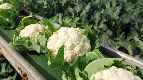 "Cauliflower Water content: 92.1%  Don't let cauliflower's pale complexion fool you: In addition to having lots of water, these unassuming florets are packed with vitamins and phytonutrients that have been shown to help lower cholesterol and fight cancer, including breast cancer. (A 2012 study of breast cancer patients by Vanderbilt University researchers found that eating cruciferous veggies like cauliflower was associated with a lower risk of dying from the disease or seeing a recurrence.)   ""Break them up and add them to a salad for a satisfying crunch,"" Gans suggests. ""You can even skip the croutons!"""