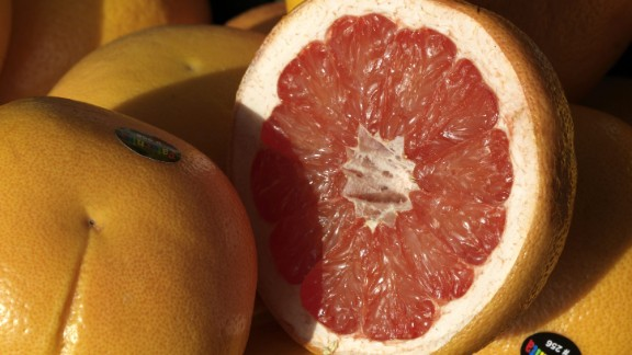 Grapefruit Water content: 90.5%  This juicy, tangy citrus fruit can help lower cholesterol and shrink your waistline, research suggests. In one study, people who ate one grapefruit a day lowered their bad (LDL) cholesterol by 15.5% and their triglycerides by 27%. In another, eating half a grapefruit -- roughly 40 calories -- before each meal helped dieters lose about 3½ pounds over 12 weeks. Researchers say compounds in the fruit help fuel fat burn and stabilize blood sugar, therefore helping to reduce cravings.