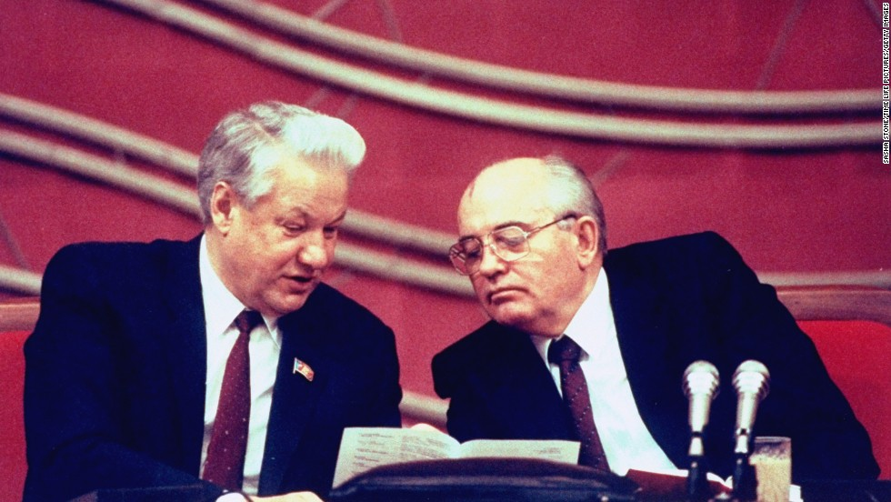 Boris Yeltsin sits with Gorbachev during a session of the Congress of People's Deputies in Moscow in 1990.