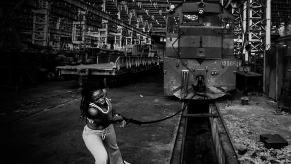 Bootless, Resurgence: A Manifesto (2013), by Nigerian photographer and performance artist Adeola Olagunju.