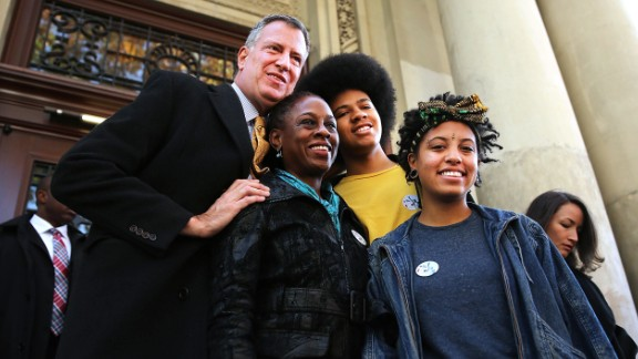 New York Mayor-elect Bill de Blasio poses with his family, wife Chirlane McCray, son Dante and daughter Chiara, after voting on Election Day.