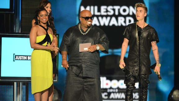 """As Bieber accepted the Milestone Award at the Billboard Music Awards in May 2013, """"very loud boos"""" competed with """"very loud cheers,"""" <a href=""""http://www.billboard.com/articles/columns/pop-shop/1563031/justin-bieber-booed-at-billboard-music-awards-understanding-the"""" target=""""_blank"""" target=""""_blank"""">the magazine reported. </a>"""