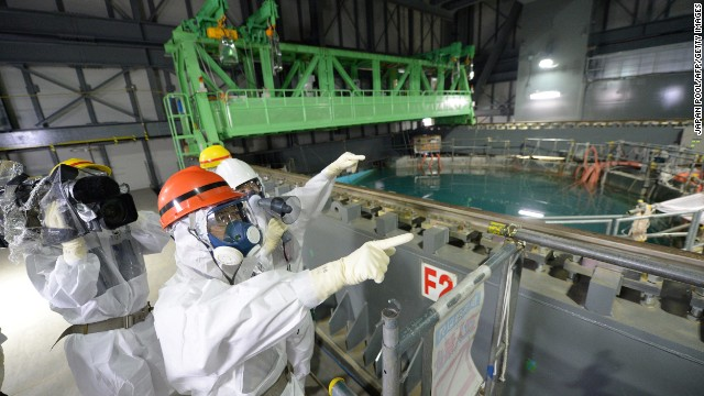 Fukushima Governor Yuhei sato (orange helmet) inspects the spent fuel pool in the unit 4 reactor building of Tokyo Electric Power Co (TEPCO) Fukushima Dai-ichi nuclear power plant at Okuma town in Fukushima prefecture on October 15, 2013. Sato also inspected contamination water tanks as radioactive water leaked early this month. AFP PHOTO / JAPAN POOL via JIJI PRESS JAPAN OUT (Photo credit should read JAPAN POOL/AFP/Getty Images)