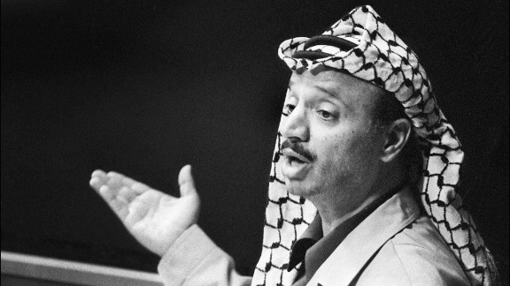 """In November 1974, Arafat addresses the General Assembly of the United Nations. """"I have come bearing an olive branch and a freedom fighter's gun,"""" he was quoted as saying. """"Do not let the olive branch fall from my hand."""""""