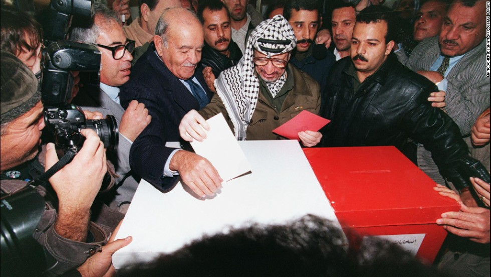 Arafat casts his ballot in Gaza City on January 20, 1996. Palestinians were voting for the first time in their history to select a president and 88-member council, and Arafat was elected president of the Palestinian National Authority.