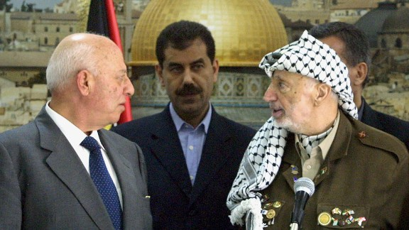 A state of emergency was declared in the Palestinian territories on October 5, 2003. Two days later, Palestinian Prime Minister Ahmed Qorei, left, and Arafat attend a swearing-in ceremony for the emergency Cabinet that was appointed.