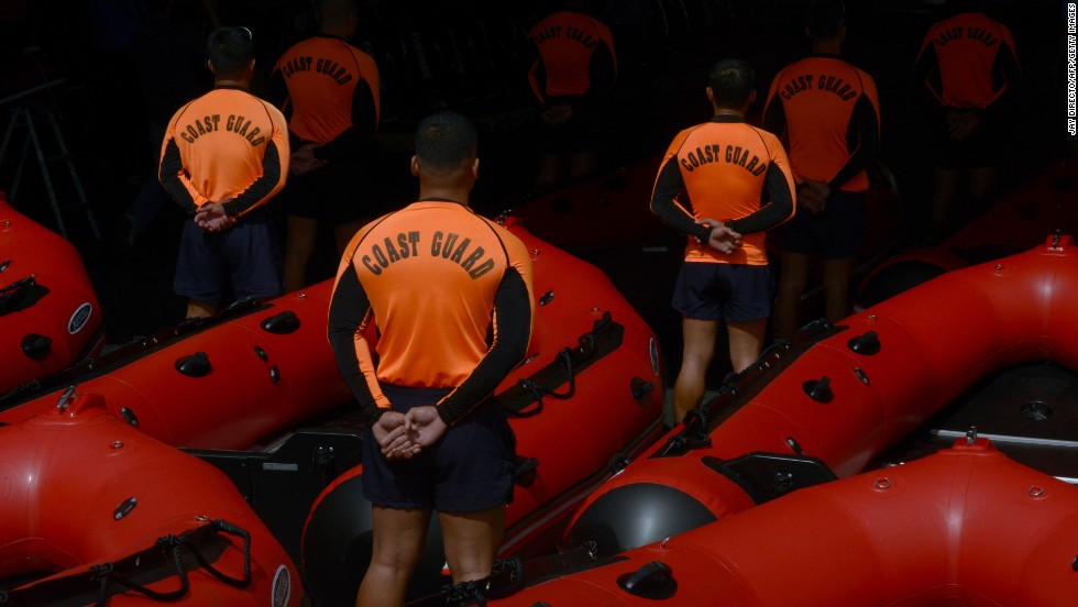Philippine Coast Guard personnel stand in formation beside newly acquired rubber boats after a blessing ceremony in Manila on Wednesday, November 6. The boats were to be deployed to the central Philippines in preparation for Haiyan.