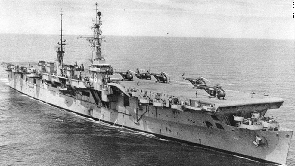 Helicopters sit on the flight deck of the USS Saipan during the mid-1950s. The ship was one of two members of the Saipan class.