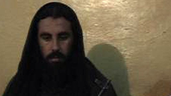 This video grab taken on November 7, 2013, shows Asmatullah Shaheen (R) caretaker chief Tehreek-e-Taliban Pakistan (TTP) announcing the new leader of TTP during a press conference in an undisclosed location in northwest Pakistan. The Pakistani Taliban appointed a hardline cleric linked to the attack on Malala Yousafzai as their new chief on November 7, throwing proposed peace talks with the government into serious doubt. Maulana Fazlullah, elected by the Taliban