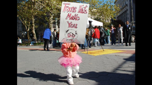 UNITED STATES - OCTOBER 30:  A young girl holds a sign during an anti-trans fat rally in Thomas Paine Park as the Board of Health holds its first public hearing on a plan to ban artificial trans fats from use in city restaurants.  (Photo by Susan Watts/NY Daily News Archive via Getty Images)