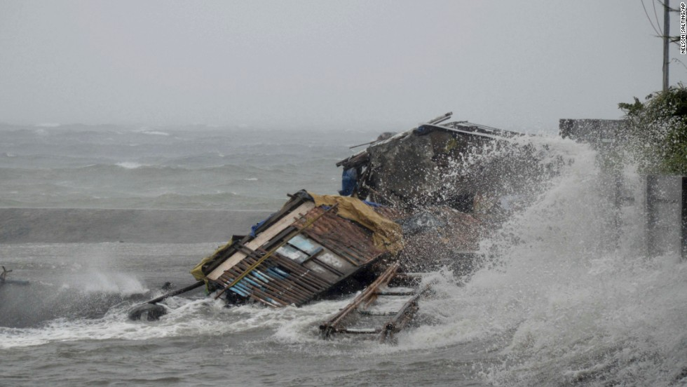 A house in Legazpi, Philippines, is engulfed by storm surge November 8.
