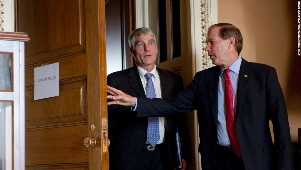 Sen. Mark Udall, D-Colorado, and his cousin Sen. Tom Udall, D-New Mexico, attend a weekly Senate policy luncheon in Washington in 2012.