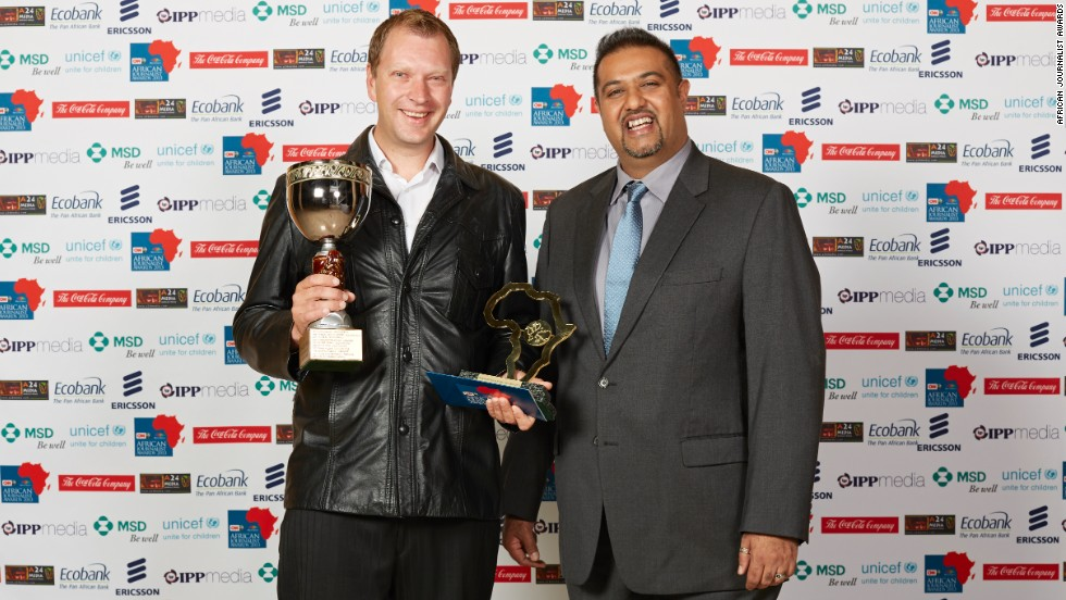 "Photojournalist Adrian de Kock (left) wins the Mohamed Amin Photographic Award for his entry ""The Jump that Started it All."""