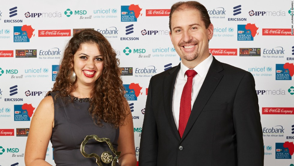 Winner of the Sport Award, Passant Rabie (left) is pictured with Nico Meyer, CEO, MultiChoice Africa.