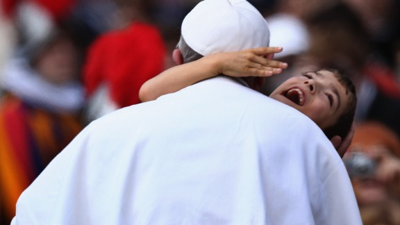 "Francis embraces a young boy with cerebral palsy in March 2013 -- a gesture that many took as a heartwarming token of the Pope's self-stated desire to ""be close to the people."""