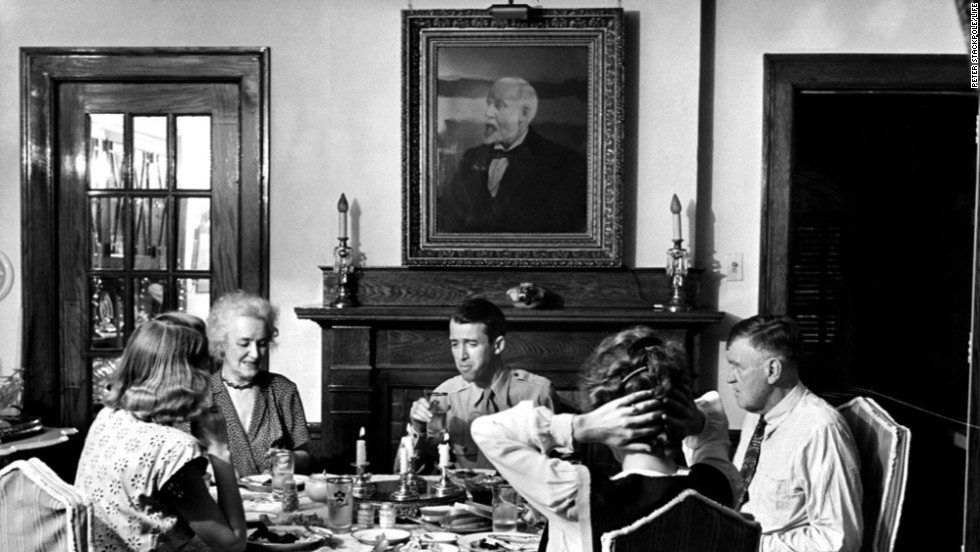 Thirty-seven-year-old Jimmy Stewart sits down at the table with his family after returning home from World War II. Stewart enrolled in the Army Air Corps in 1941 after being turned down for being too skinny. He flew dozens of combat missions, some as command pilot, and returned home to Indiana, Pennsylvania, a decorated colonel.