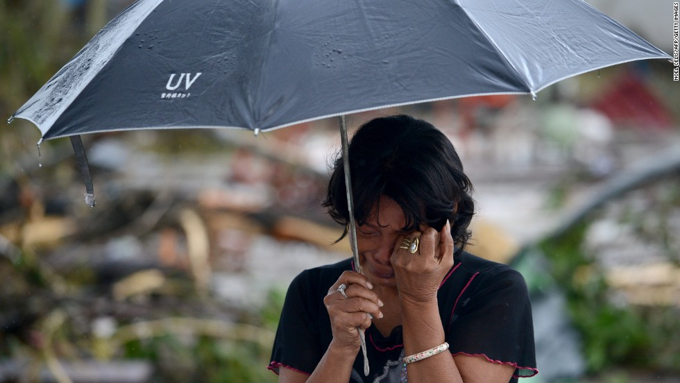 A woman mourns in front of her husband's dead body November 10 in Tacloban.