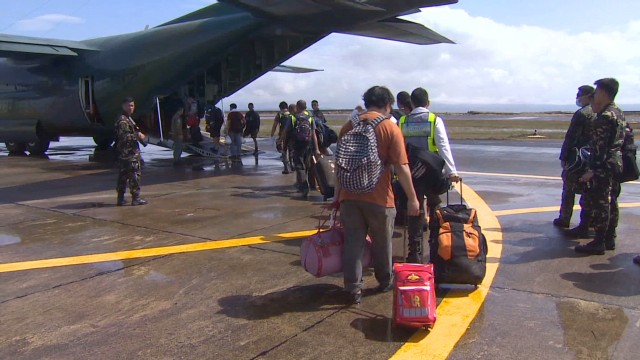 Typhoon survivors seek help at airport