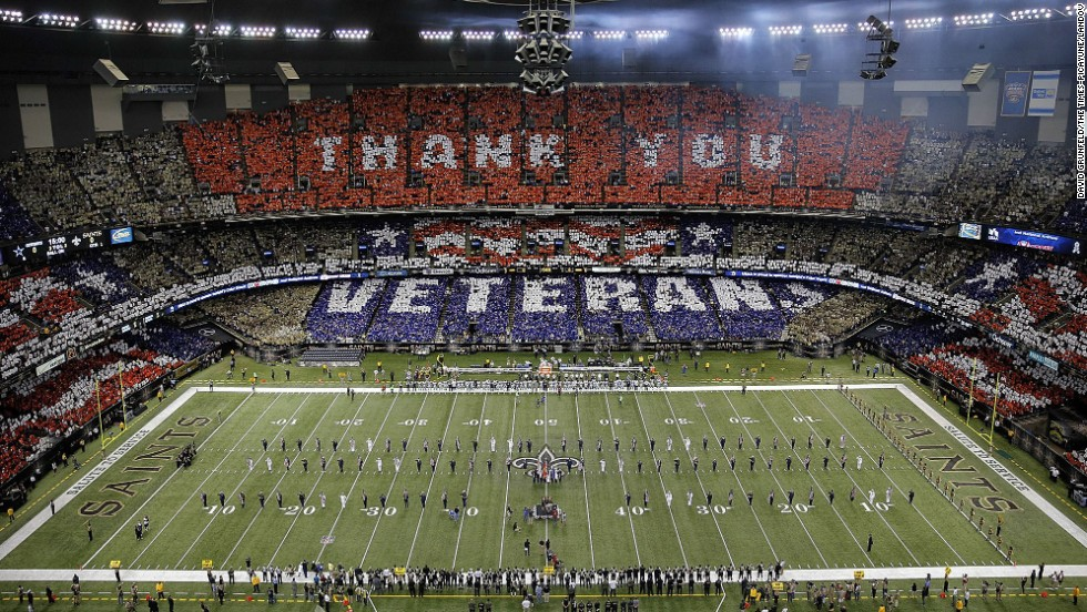 Veterans are honored before the start of Sunday's NFL football game between the New Orleans Saints and the Dallas Cowboys at the Superdome in New Orleans.