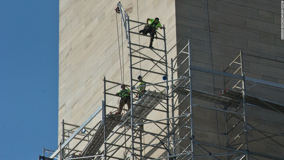 Workers walk on scaffolding around the monument as repairs continue in April 2013.