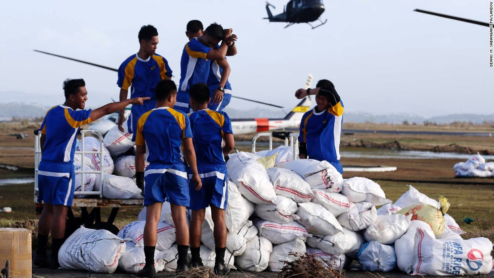 Philippine Air Force personnel prepare to load relief supplies at the Tacloban airport on November 11.