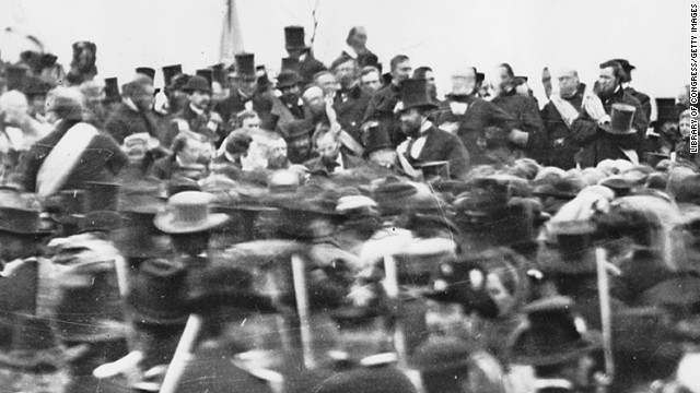 Abraham Lincoln arrives to deliver the Gettysburg Address, center right, November 19, 1863.