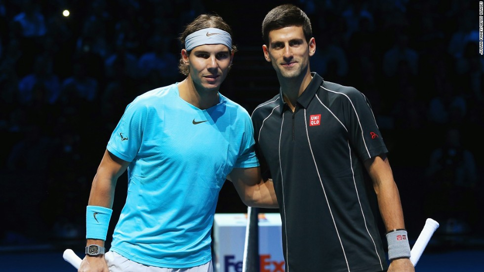 Posing for the camera. Nadal and Djokovic complete the formalities before beginning their ATP Tour Finals showdown.