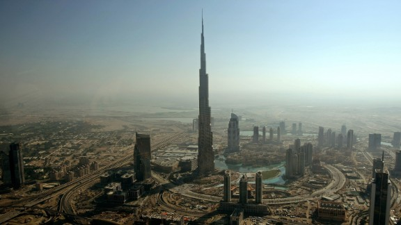 Completed in 2010 in Dubai, Burj Khalifa's architectural height is 2,717 feet (828 meters) and is occupied to a height of 1,918 feet (584.5 meters). A building's architectural height may include spires, but not antennas, flag poles or signage, according to the Council on Tall Buildings criteria.
