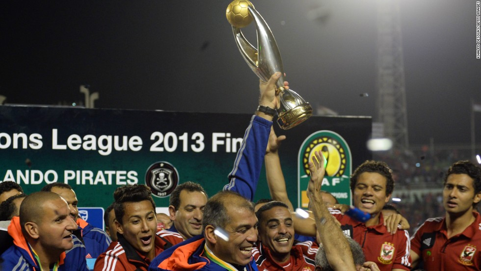 Al Ahly coach Mohamed Youssef holds aloft the African Champions League, a triumph that means the Egyptians will represent the continent at next month's FIFA Club World Cup in Morocco.