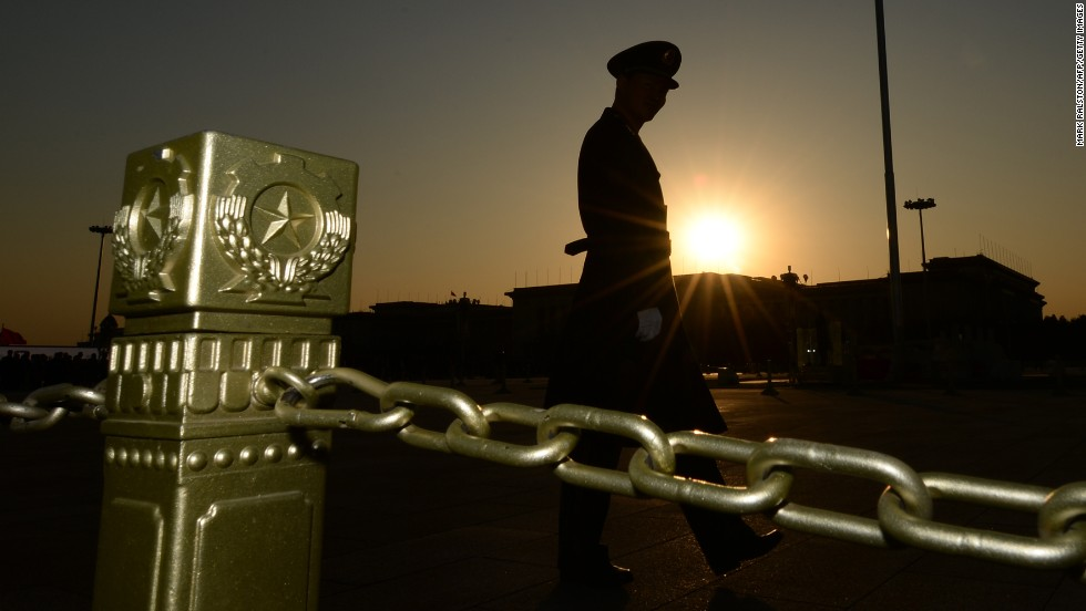 "NOVEMBER 12 - BEIJING, CHINA: A Chinese paramilitary officer patrols Tiananmen Square in front of the Great Hall of the People after the Communist Party concluded its third plenum. <a href=""http://cnn.com/2013/11/08/world/asia/china-plenum-jaime/index.html"">China watchers will be looking closely to see if this gathering becomes a launchpad for major new reforms</a>, as the meetings have in the past."