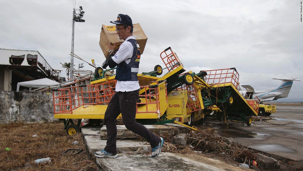A member of the Japanese Disaster Relief Team carries goods in Tacloban on November 12.