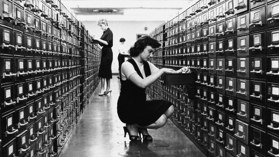 Then: The card catalog was a formidable piece of furniture found at every library. On its thousands of cards: title, author, subject and call number -- sometimes with handwritten notations. Now: Google. The world's knowledge at your fingertips. So much for roaming the aisles of the Dewey Decimal System.