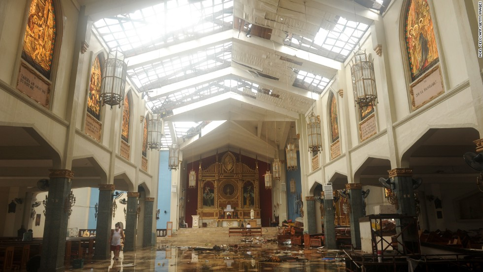 An image of Santo Nino Church in Tacloban, Leyte on November 12, 2013, a few days after Super Typhoon Haiyan. Its roof has been torn off. The image matches video seen on television where a man believed to be Rogelio Tan was praying.
