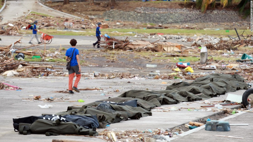 Body bags are lined up in Tacloban on November 13.