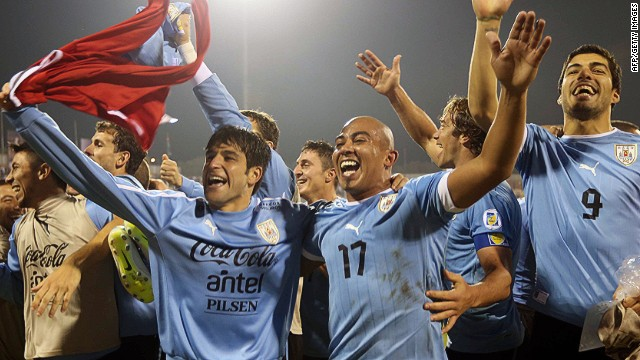 Uruguay's players celebrate after their 5-0 triumph in the first leg of their World Cup playoff with Jordan.