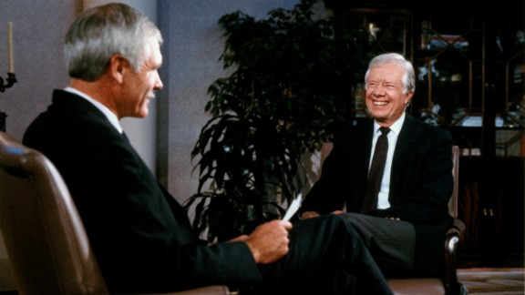 Turner talks with former U.S. President Jimmy Carter in 1989.