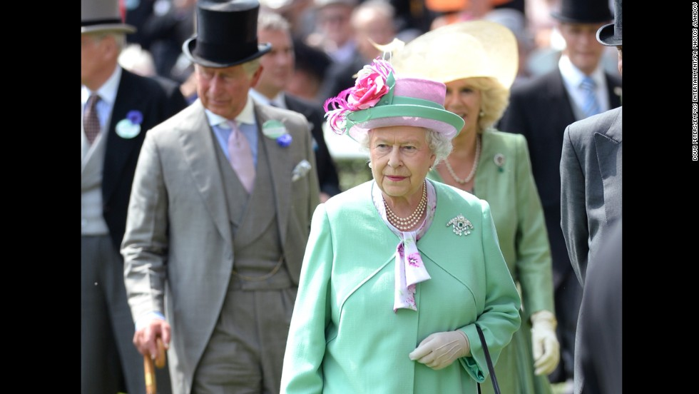 Charles strolls behind his mother in a top hat and umbrella on day two of the Royal Ascot Meeting 2013 horse race in Berkshire.