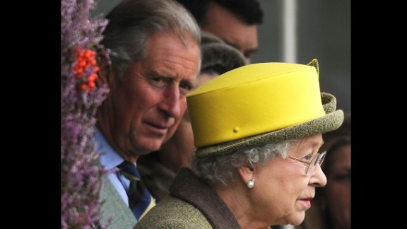 Charles looks over at his mother as they attend the 2009 Braemar Highland Games in Scotland.