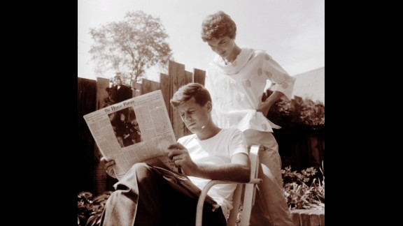 Jackie looking over John's shoulder as he reads the May 7 issue of the Christian Science Monitor on May 9, 1954, Mother's Day.