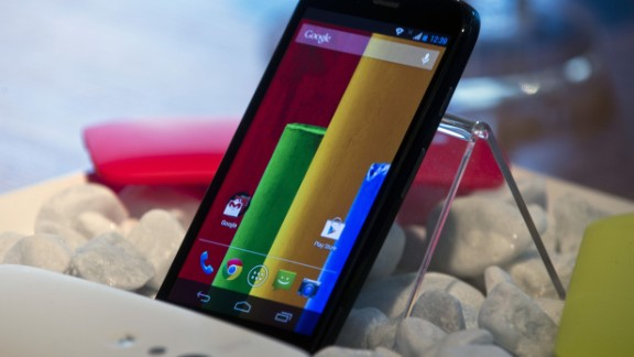 "Google, Android. The new low cost smartphone of Motorola, ""Motorola Moto G"", is displayed in Sao Paulo, Brazil on November 13, 2013. The smartphone, with dimensions 65.9mm W x 129.9mm H x 6.0 - 11.6mm D is equipped with a Qualcomm Snapdragon 400 with quad-core 1,2 GHz CPU, a 4.5-inch display and Android Operating System 4.3 and a suggested price of $ 179 USD. AFP PHOTO / NELSON ALMEIDANELSON ALMEIDA/AFP/Getty Images"