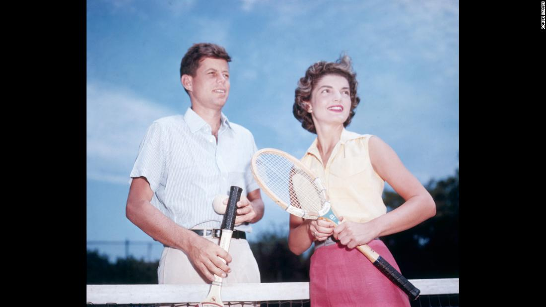 John Fitzgerald Kennedy and his fiancée, Jacqueline Lee Bouvier, playing tennis in 1953. They were one of history's power couples, a dashing Democrat and an elegant wife. They were both from influential families and became superstars before he entered the White House. Take a look back at the couple that embodied the image of a perfect family.