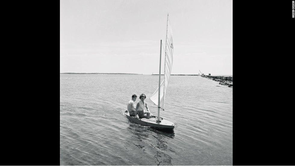 The then-senator engages in his favorite pastime of sailing at Hyannisport, Massachusetts, with Jackie in July 1960.