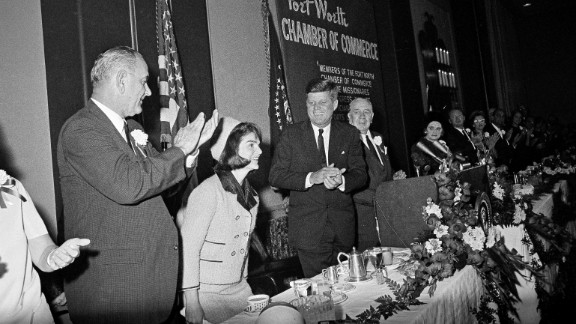First lady Jacqueline Kennedy at a breakfast held by the Chamber of Commerce in Fort Worth with Vice President Lyndon B. Johnson, left, and Kennedy.