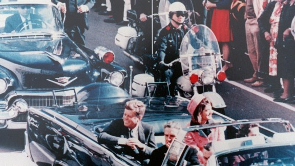 """Dallas Police Officer Bobby Hargis, background, is one of four motorcycle officers assigned to Kennedy's car, which reaches Houston Street shortly before 12:30 p.m. """"I thought, 'Well, we've got it made now,' """" Hargis said. """"And then bam! It happens."""""""