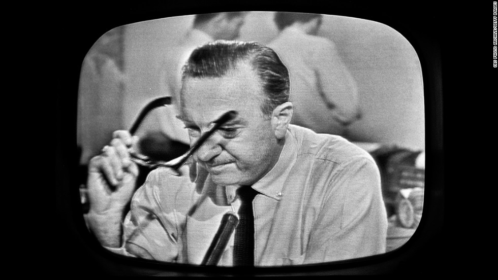 American broadcast journalist and anchorman Walter Cronkite removes his glasses and prepares to announce Kennedy's death. CBS broadcast the first nationwide TV news bulletin reporting on the shooting.