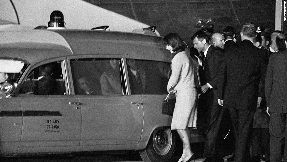 Jacqueline and Robert Kennedy get into the Navy ambulance with the president's body at Andrews Air Force Base, just outside Washington. The body of the president is taken to Bethesda Naval Hospital for an immediate autopsy.