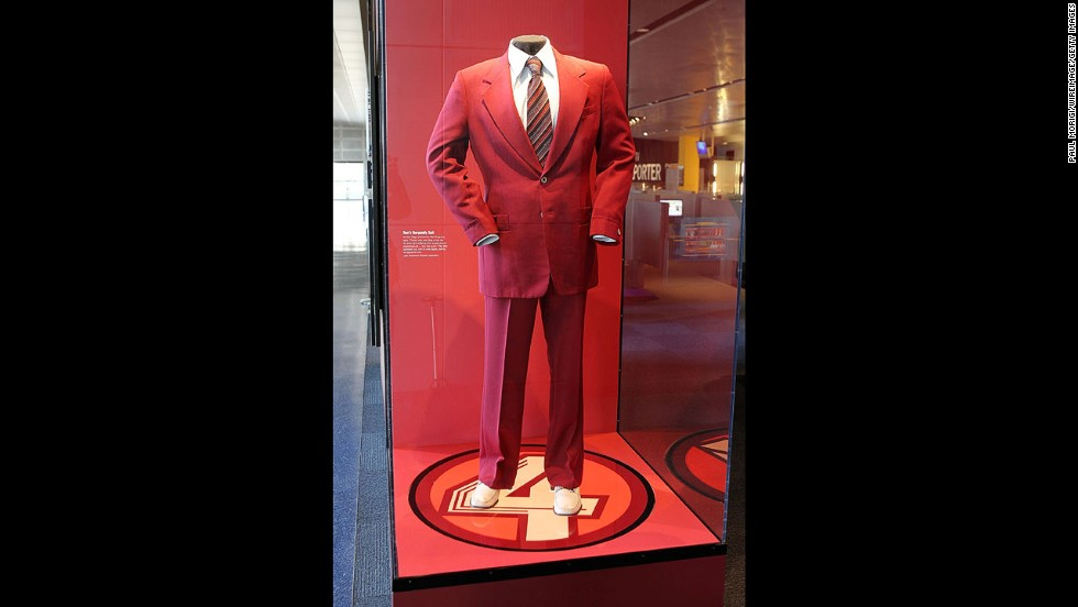 Anchorman Ron Burgundy's signature suit is prominently featured in a revolving glass case.