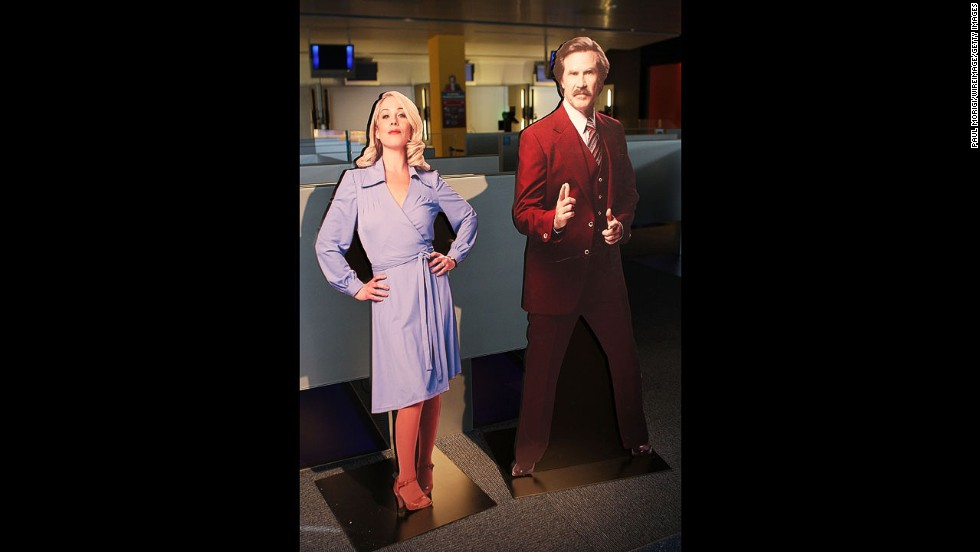 "Life-size cutouts of characters Veronica Corningstone and Ron Burgandy are on display at ""Anchorman: The Exhibit."""